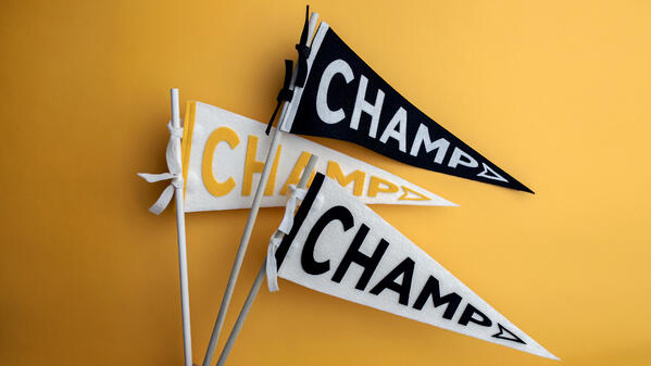 """3 flags with """"champ"""" written on them"""