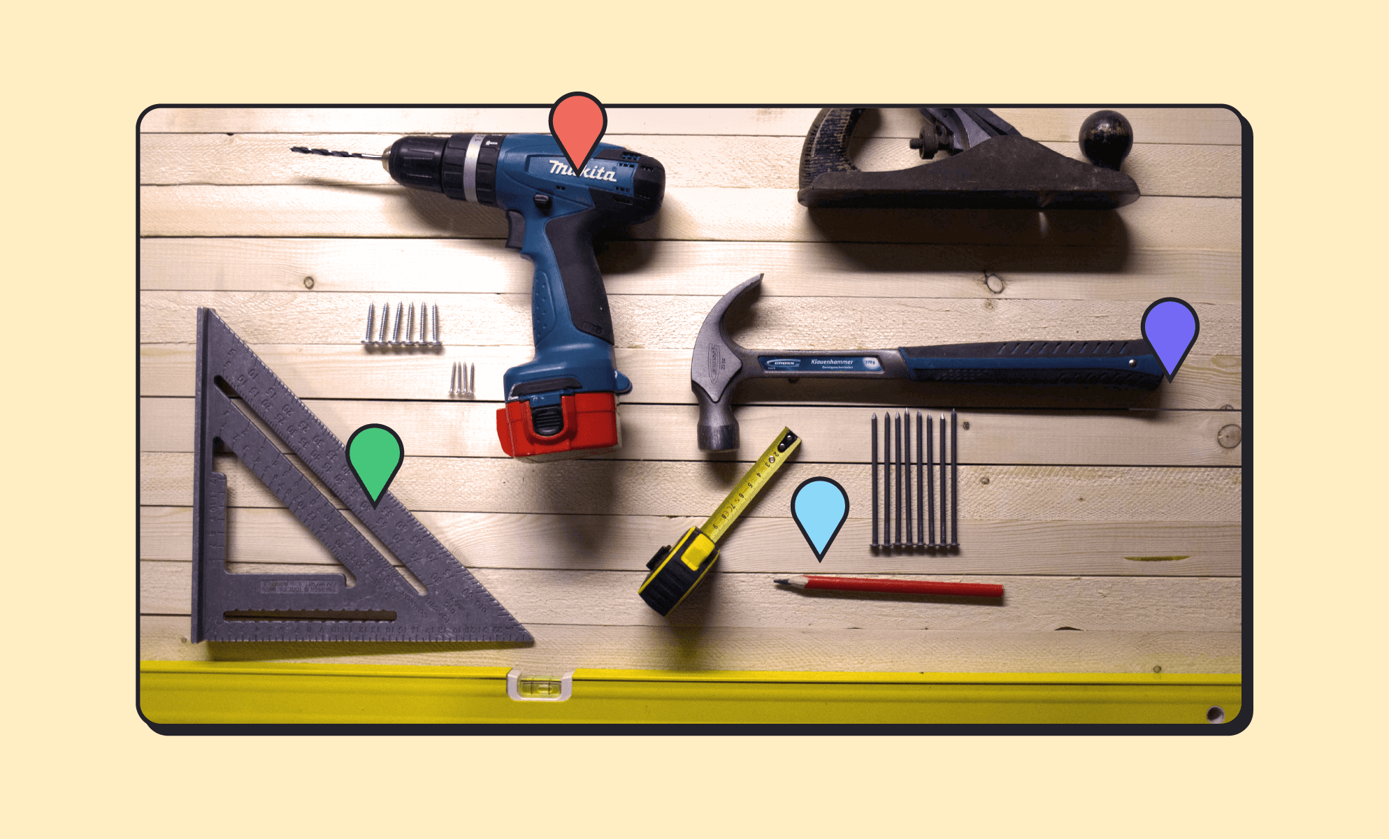 Construction and power tools on a wood table, including a Mikita drill, ruler, planer, hammer, tape measure, pencil, and drill bits. (BrainStorm, Inc. - Oct. 2021)