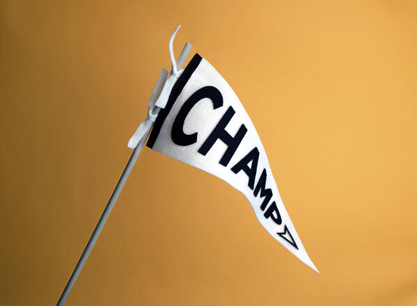 """A triangular flag with """"Champ"""" spelled on it"""