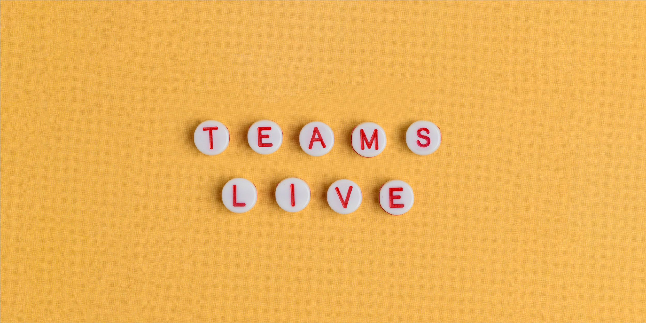 """""""Teams Live"""" spelled out in white beads with red letters"""