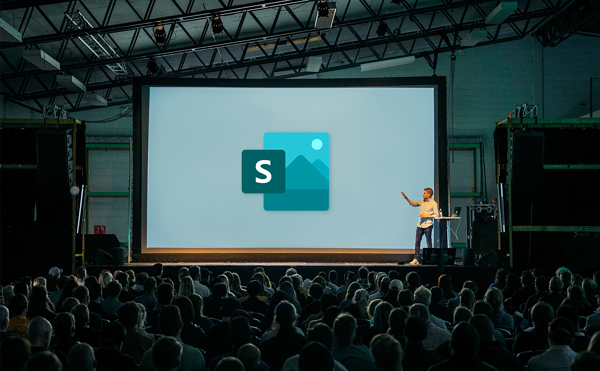 A person presenting with Microsoft Sway on a big screen behind them.