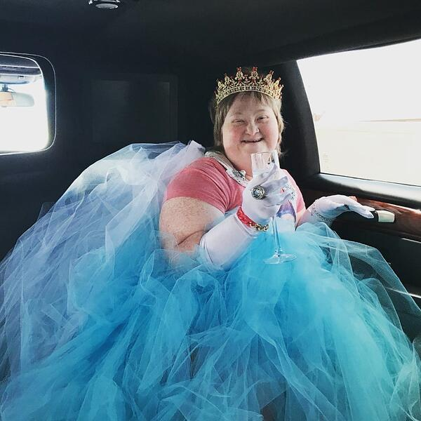 Princess Sarah wearing a tutu and crown in a limo