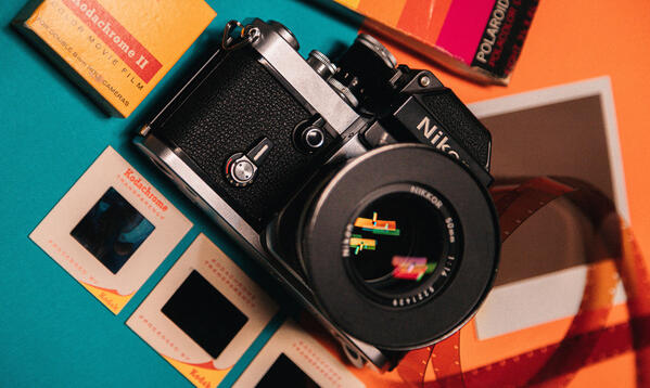 Image of an old Nikon camera on a brightly colored background